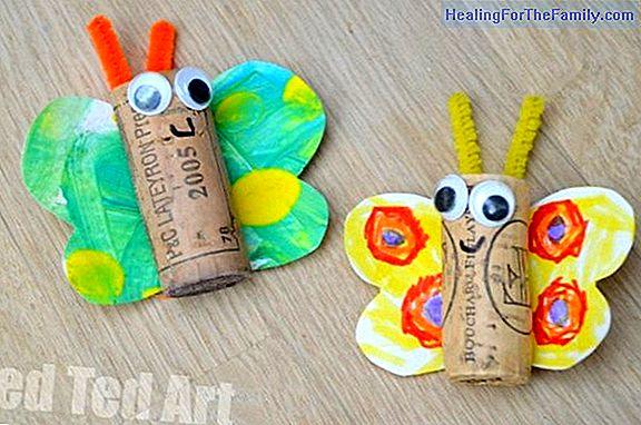 Cork butterfly in a garden. Crafts for children